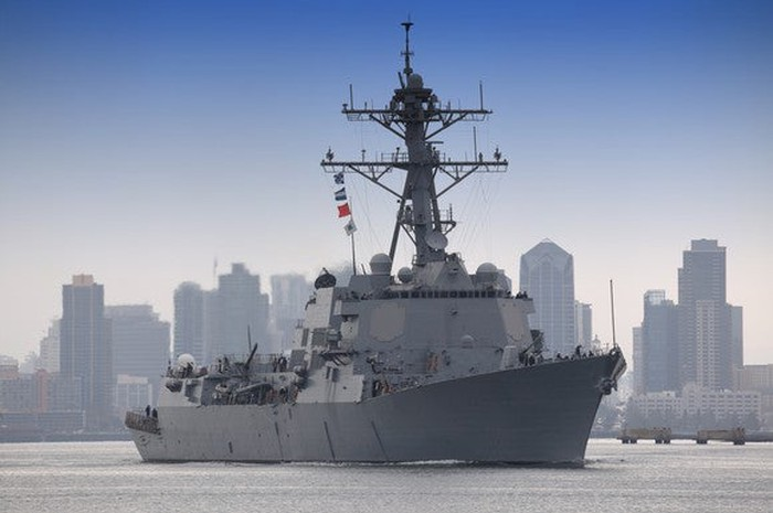 A Navy ship leaving port.