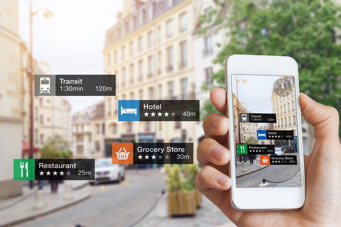 An augmented-reality view of a city street showing transit, hotel, shopping options.
