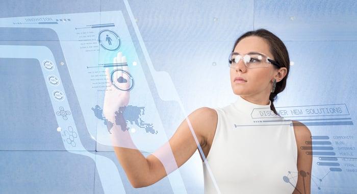 A woman using a digital control panel