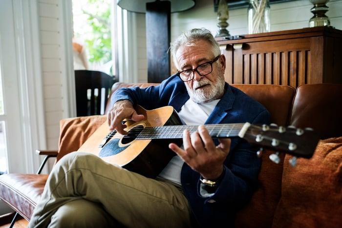 Older man playing guitar