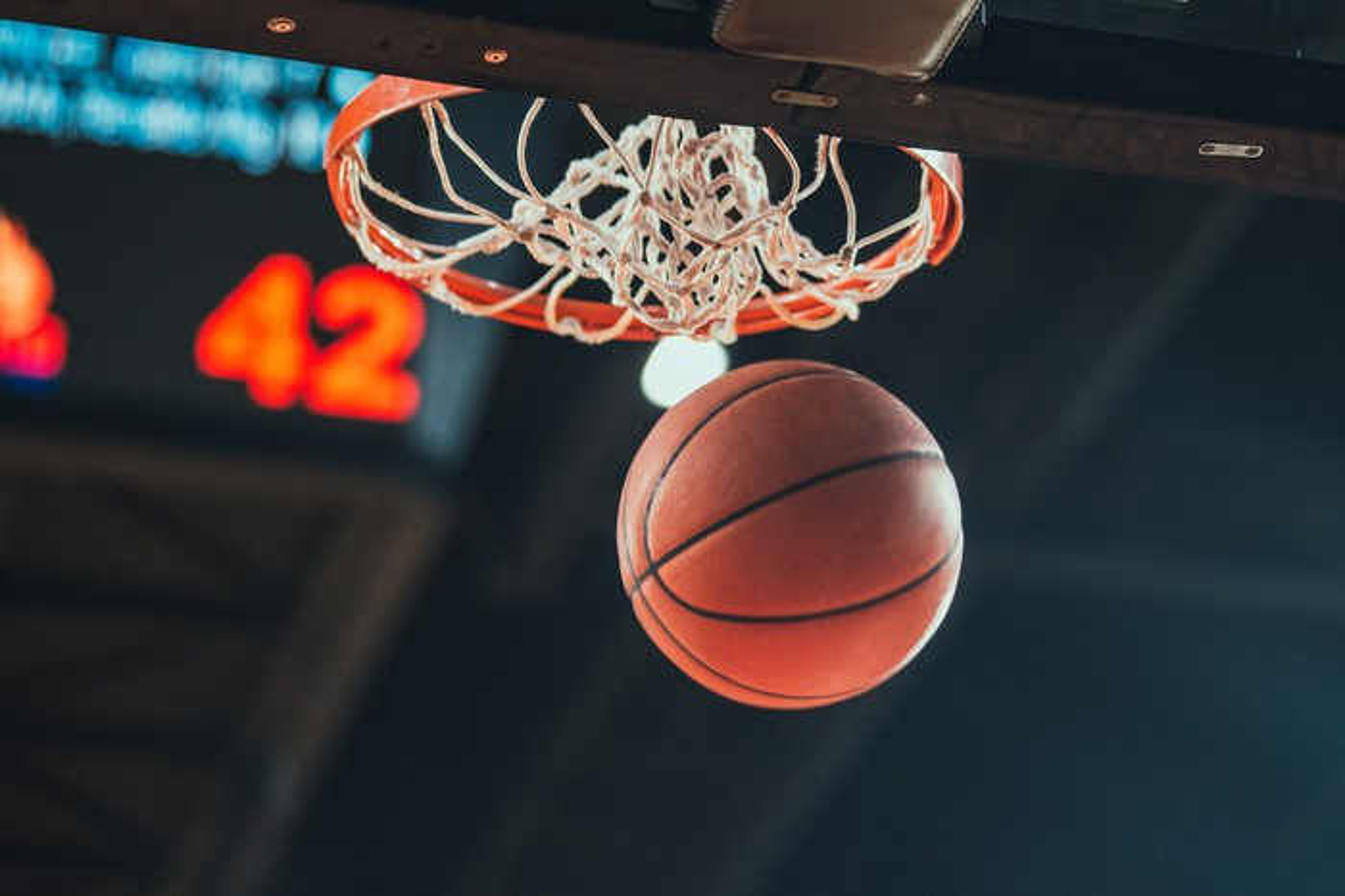 A basketball swishing through the hoop