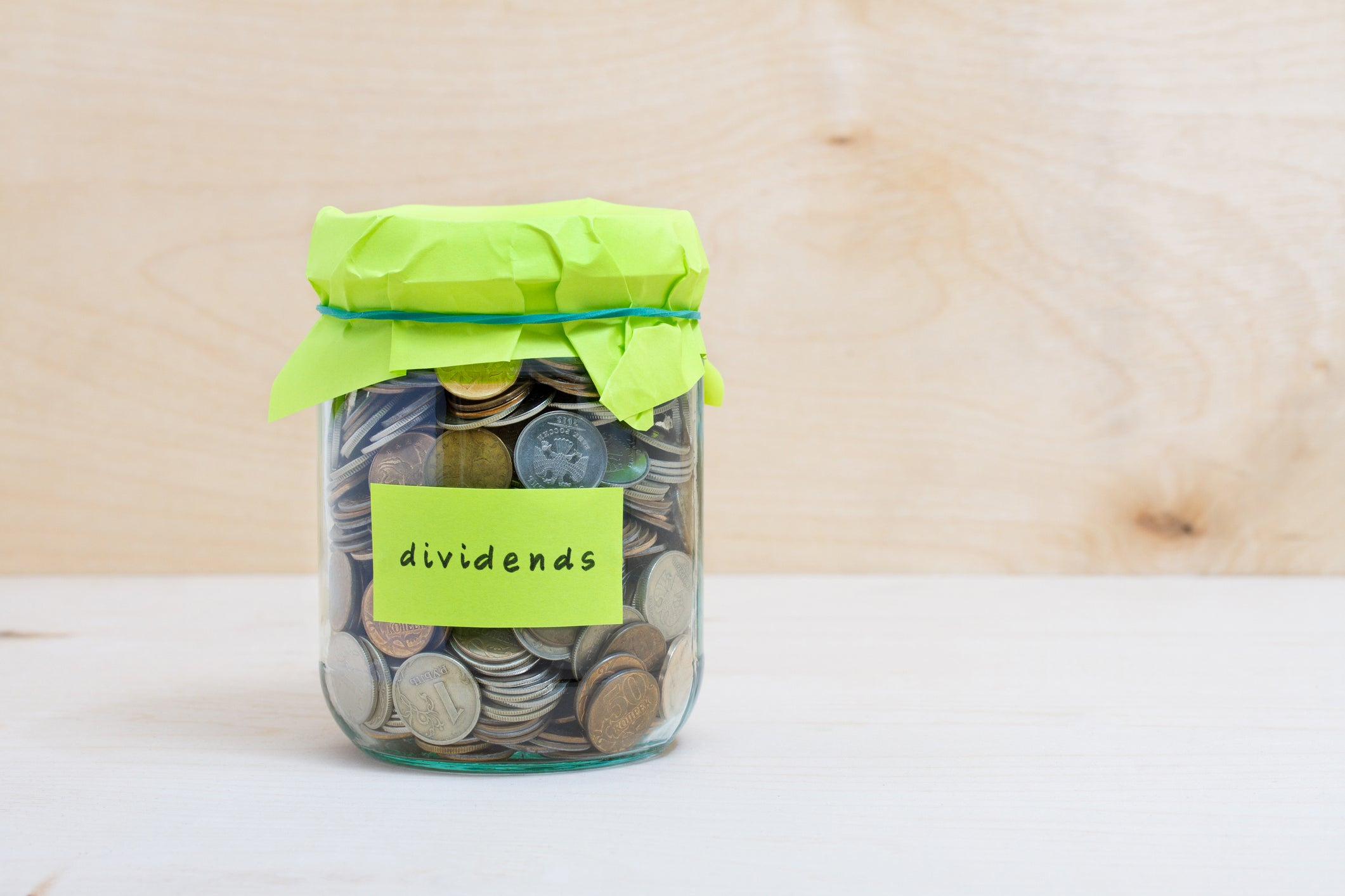 """A jar of coins labeled """"Dividends"""""""