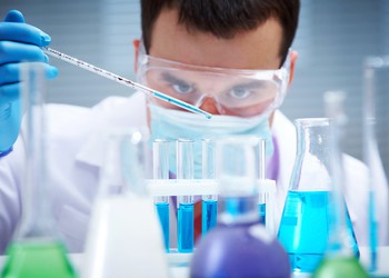 160623 Getty Chemist in Lab with Test Tubes