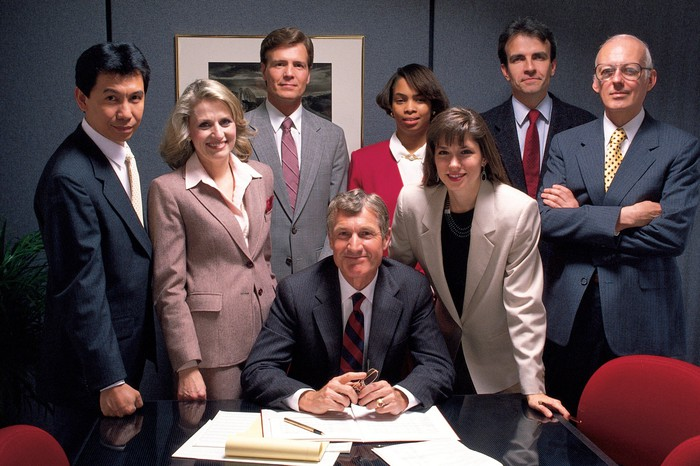 A group of executives in a corporate conference room.