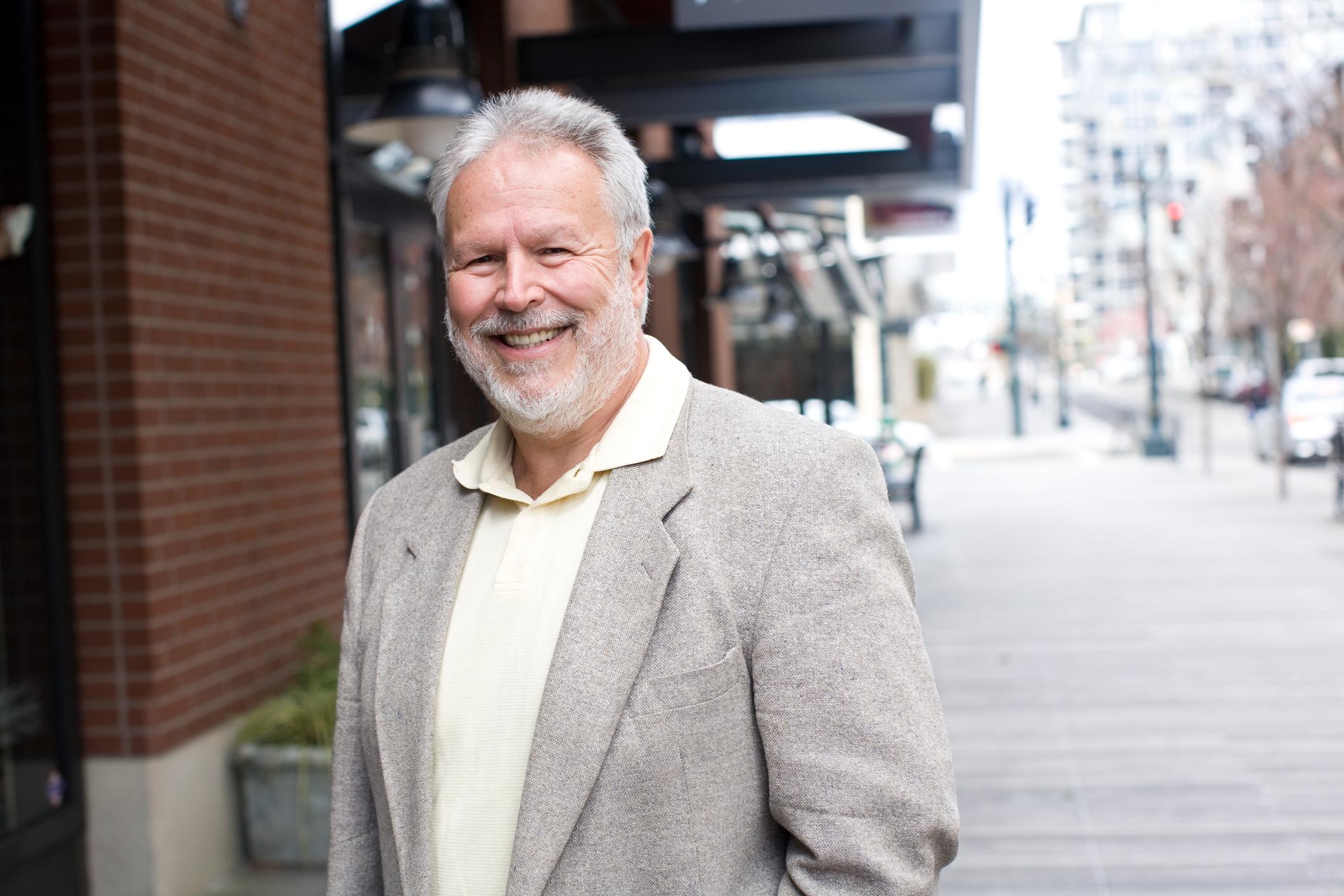 A smiling senior man on the street.
