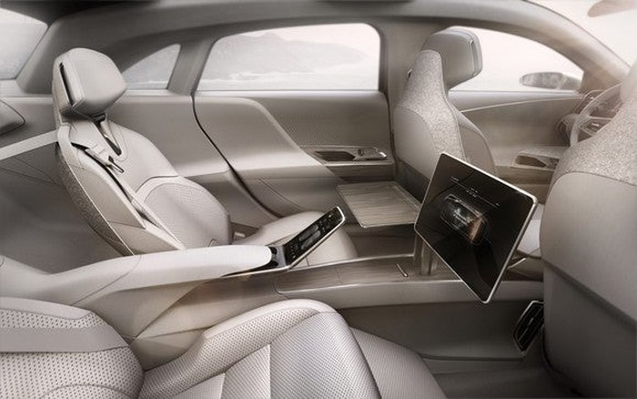 Interior of sedan, showing roomy backseat.