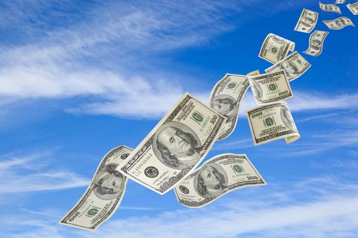 Hundred-dollar bills flying through the air