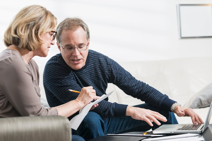 Older man and woman reviewing documents
