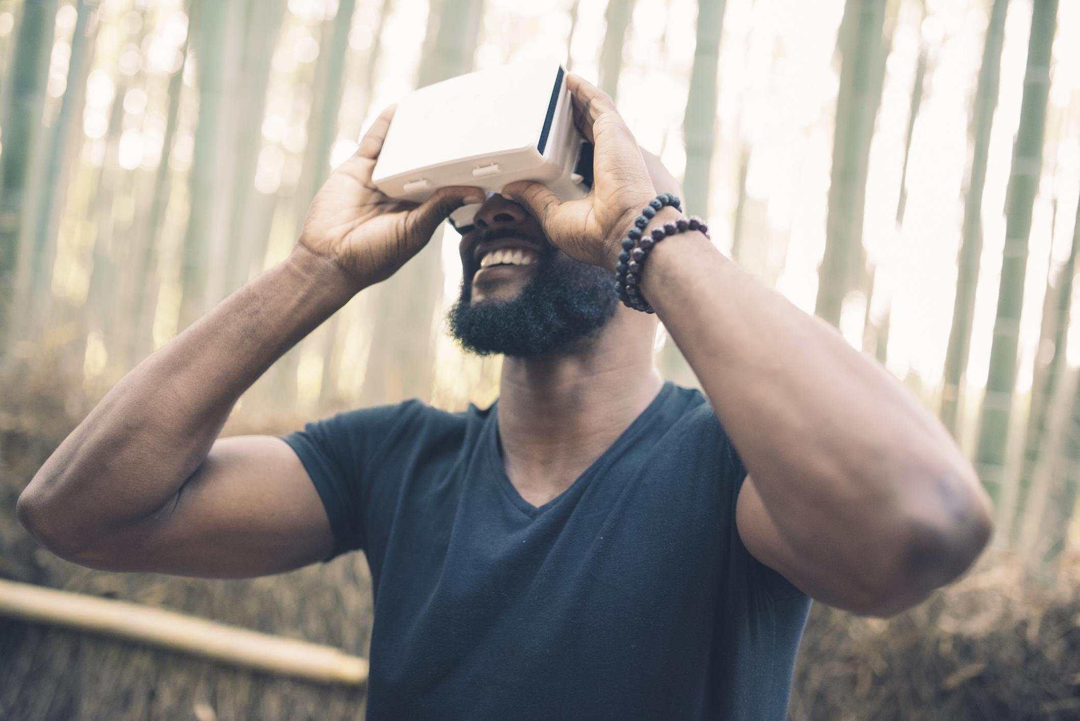 A man looking through VR googles