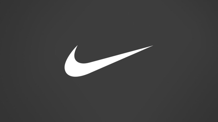 White Nike swoosh logo on dark background