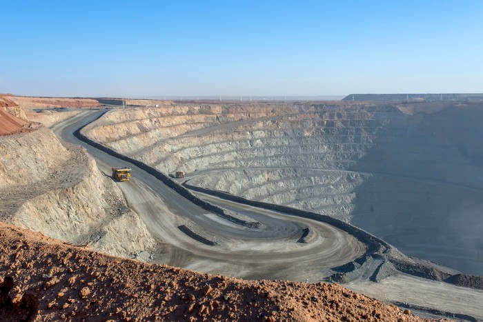 Open pit mine with a truck driving out of it