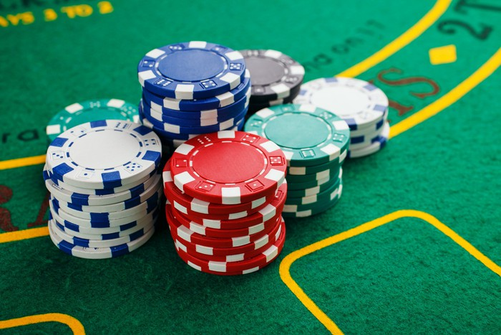Stacks of poker chips on green felt table