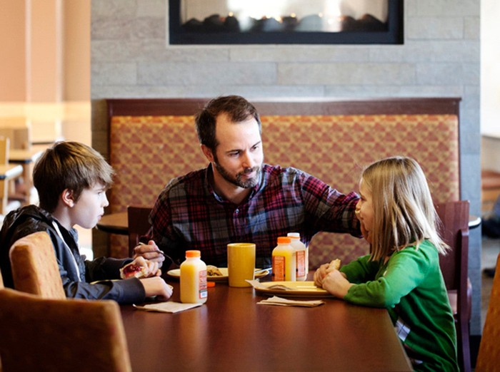 Family enjoying a meal at Panera Bread.