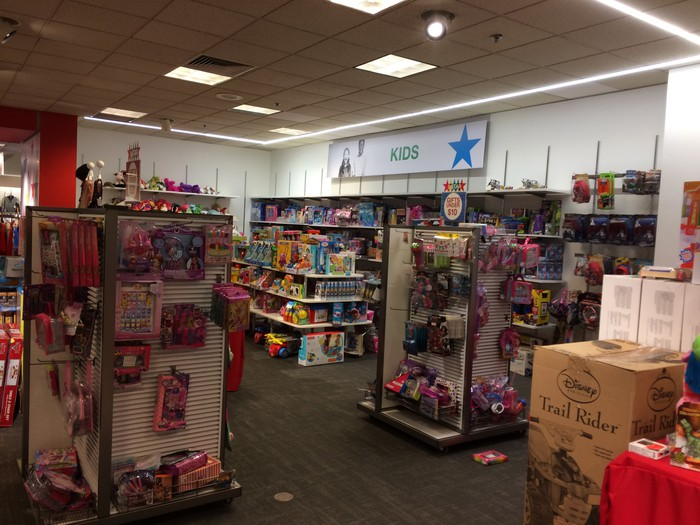 Kids' toy department inside of a Macy Backstage store