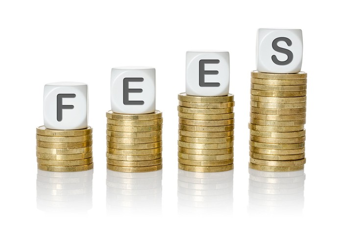 """Coin stacks with dice spelling """"fees"""""""