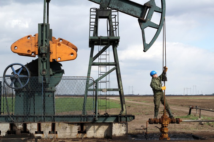 Picture of worker at oil pumpjack