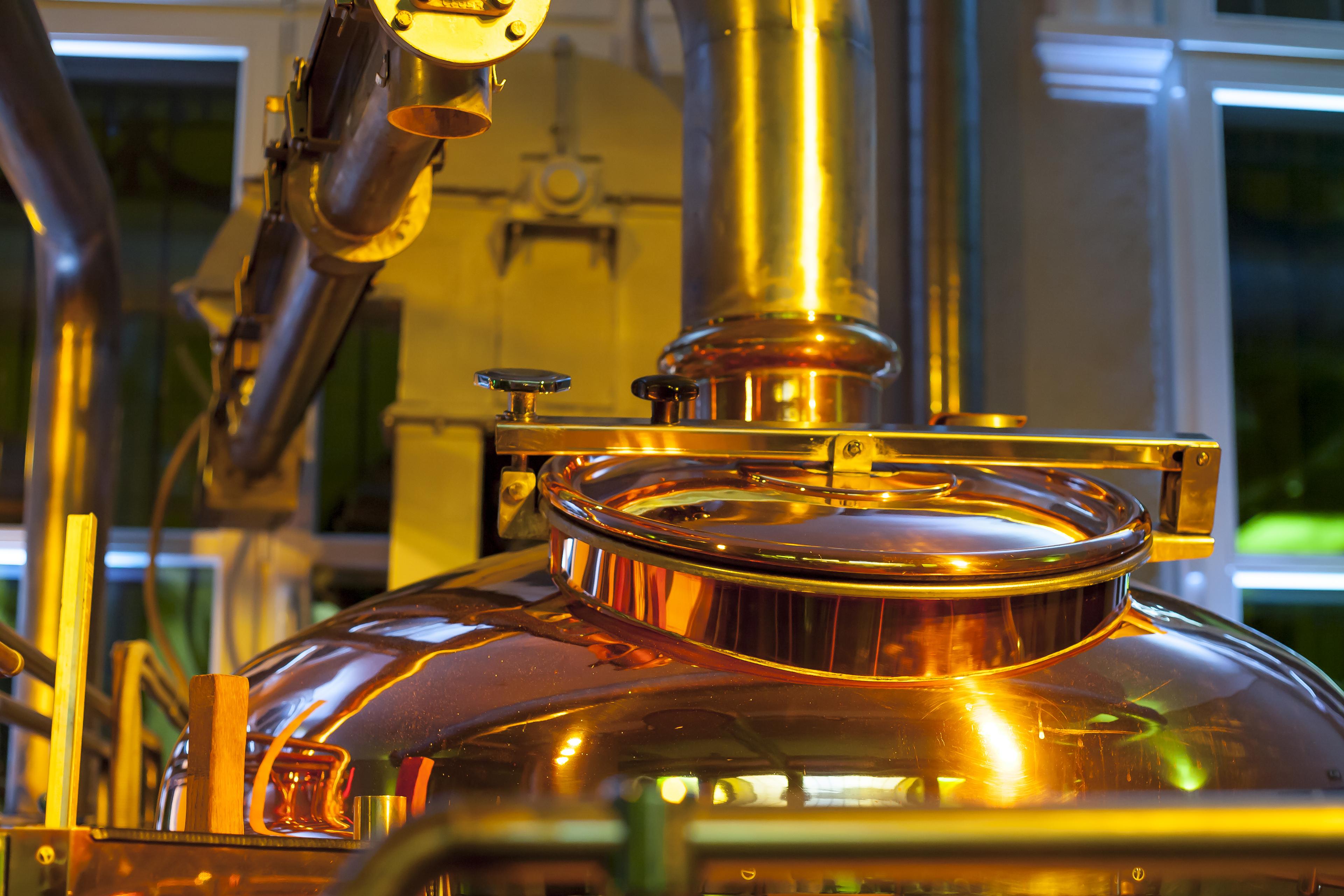 Copper tank in distillery.