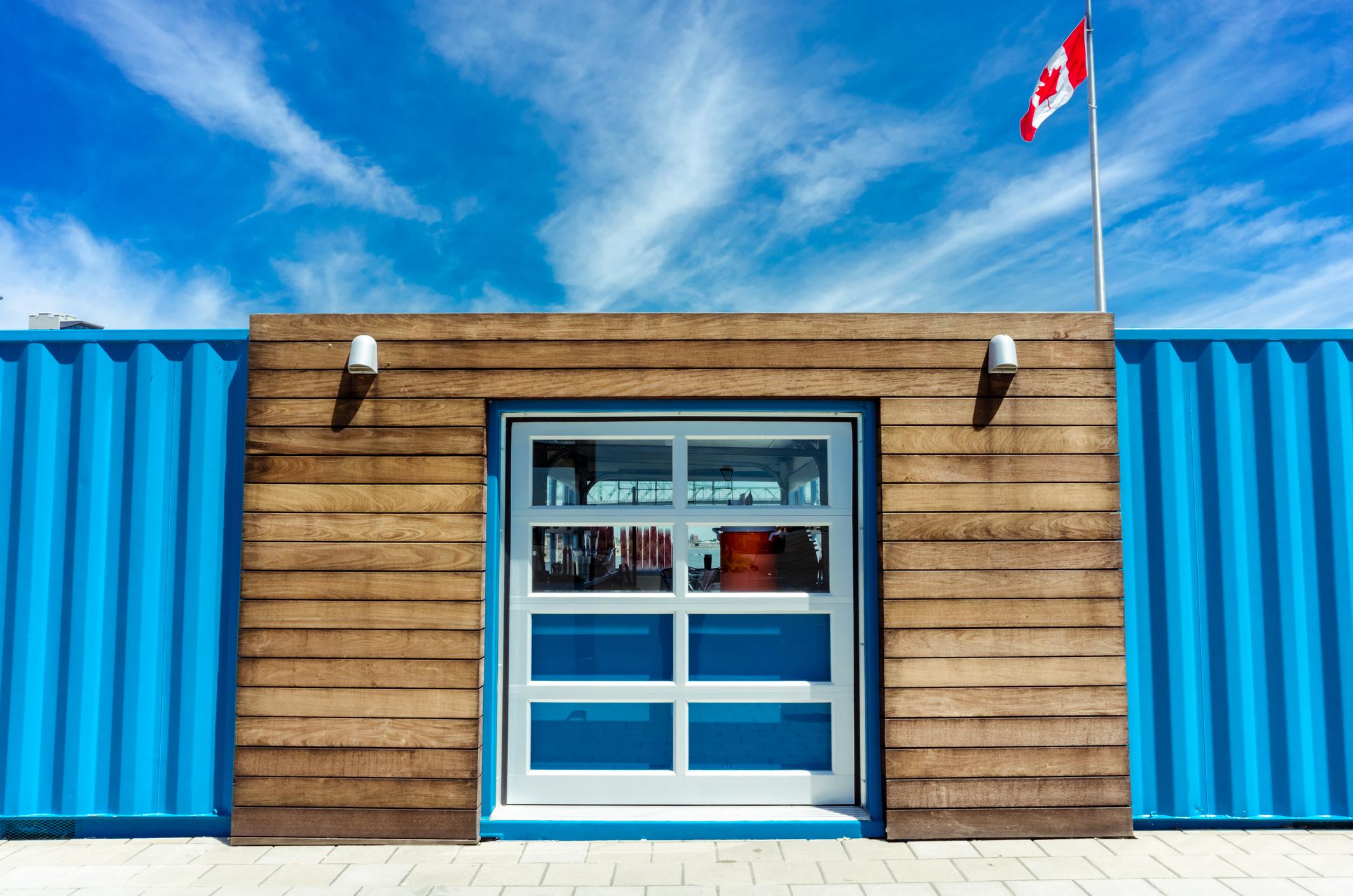 A temporary building under a blue sky.