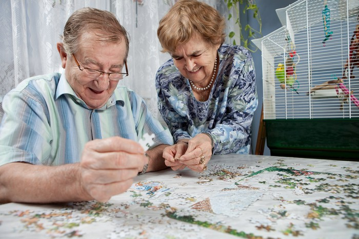 Retired couple working on a puzzle