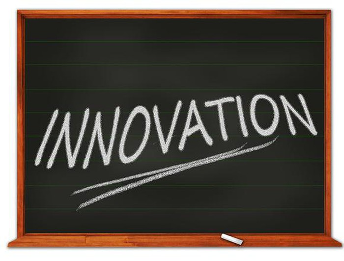 "The word ""innovation"" written on a chalkboard."