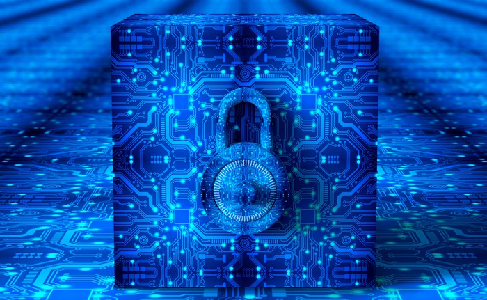 Cybersecurity depicted by a lock inside computer circuitry