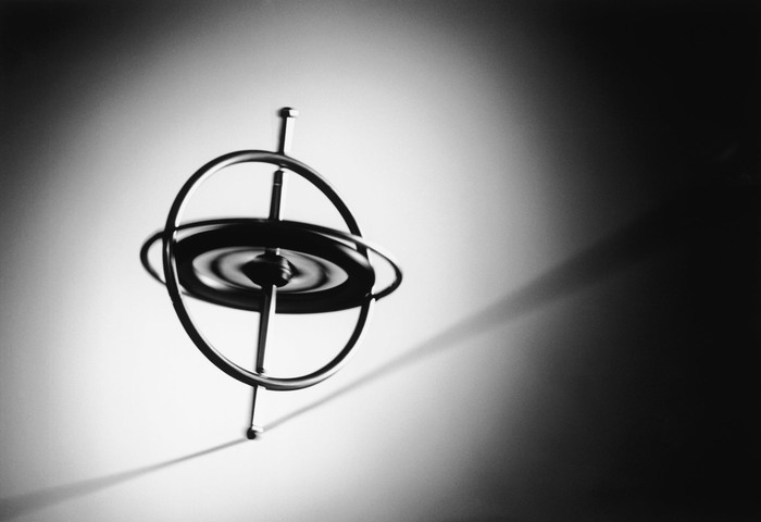 Spinning gyroscope on wire, representing InvenSense's smaller, electronic equivalents.