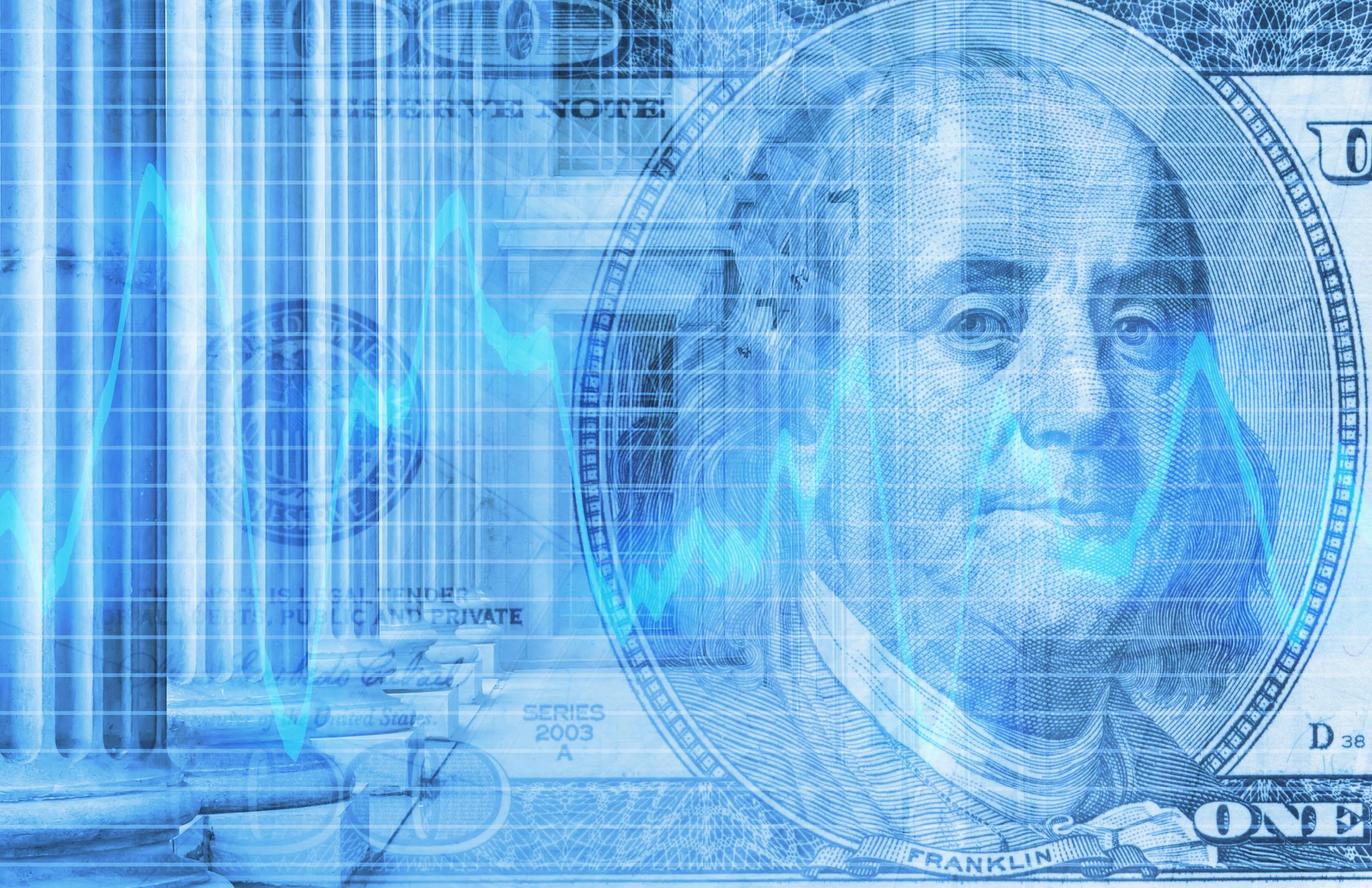 One-hundred dollar bill and stock market chart