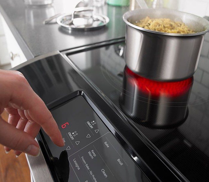 A digital display panel on a Whirlpool cooktop