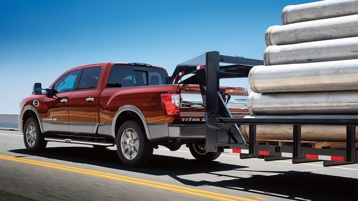 2017 Nissan Titan towing a loaded trailer
