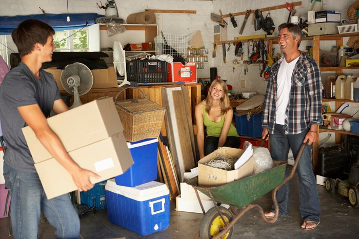 Family cleaning old unused items out of garage
