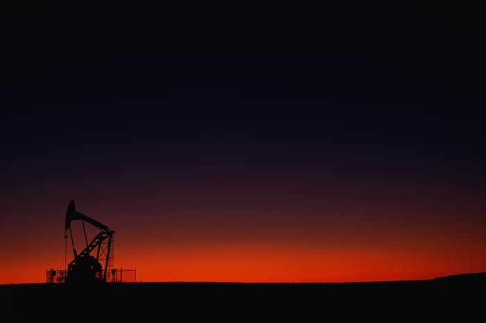 oil pumpjack at night