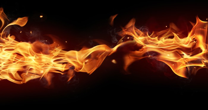 A flame burning across a black background.