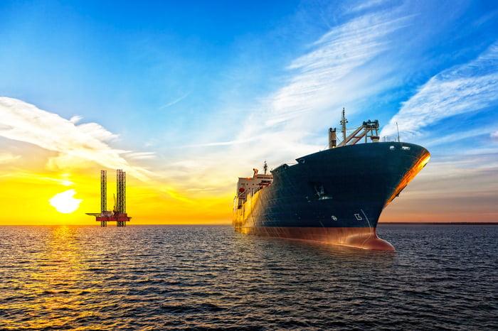 Oil tanker at sea at sunset.