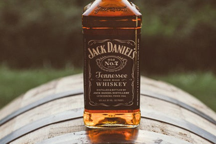 Bottle of Jack Daniel's whiskey sitting on a barrel