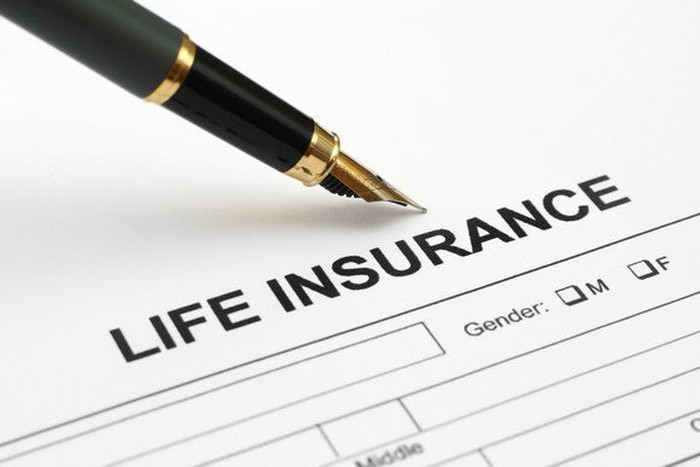 Life insurance paperwork with pen.