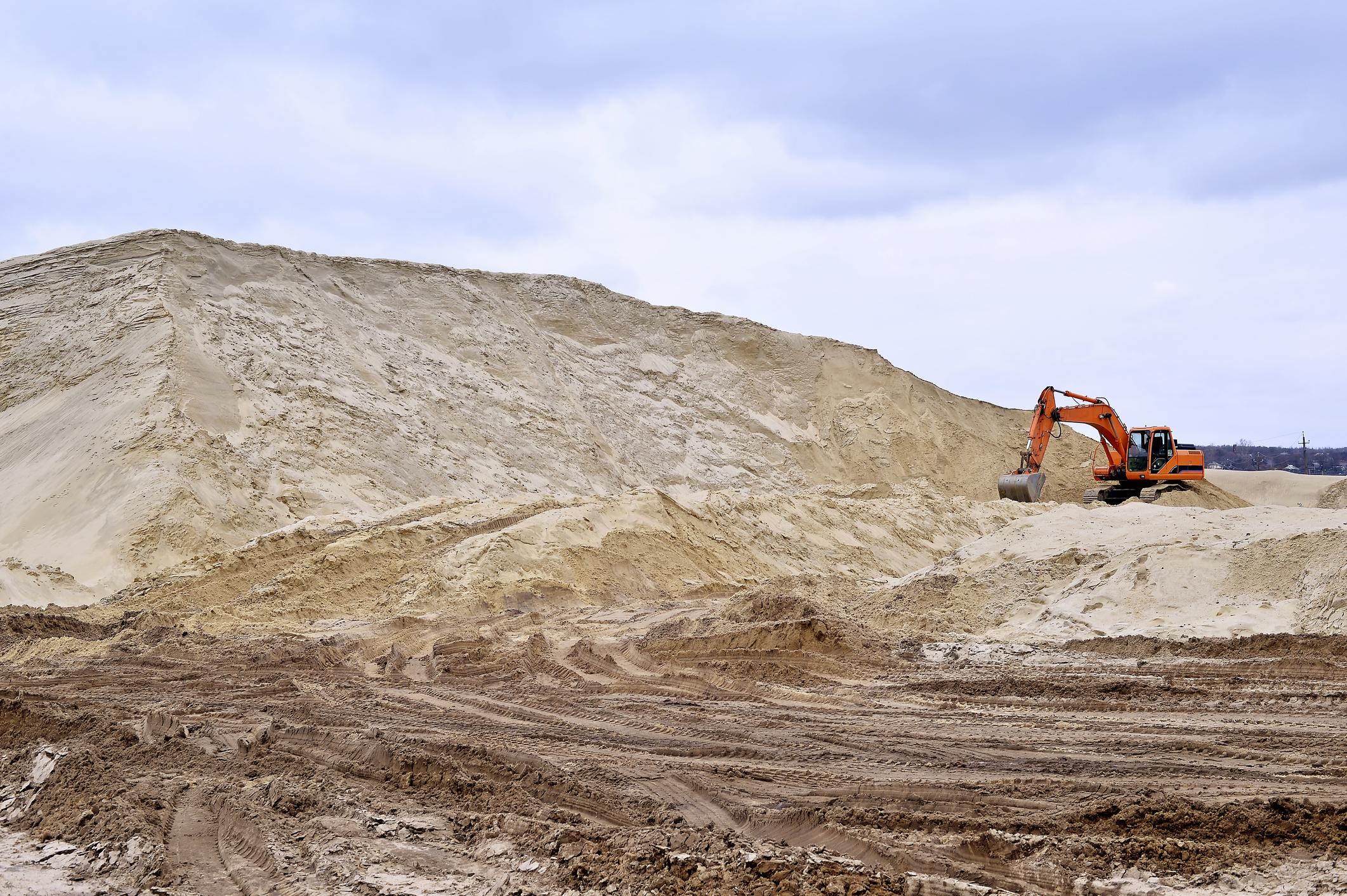 Excavator in sand mine