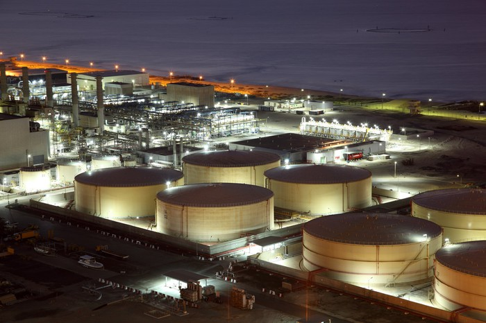 Oil refinery storage tanks at night
