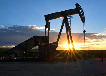 Pump Jack with the sun setting in the background