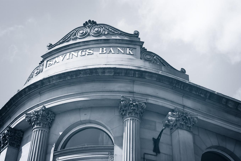 The facade of a stone bank building.
