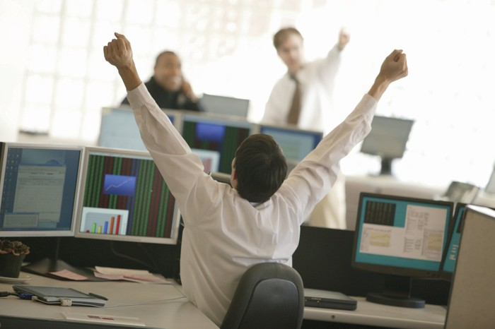 Excited stock owner watching share price rise