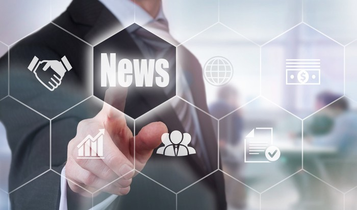 Man pointing to news