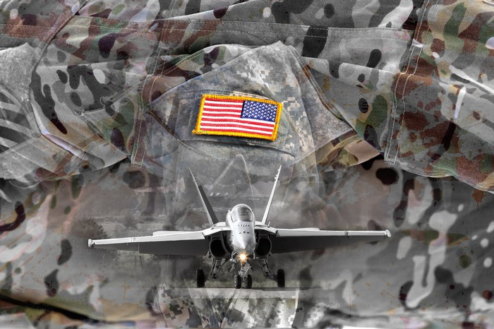 Fighter jet superimposed on fatigues with flag icon.