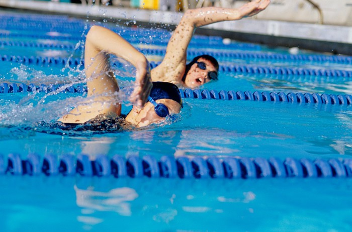 Two female swimmers racing in pool