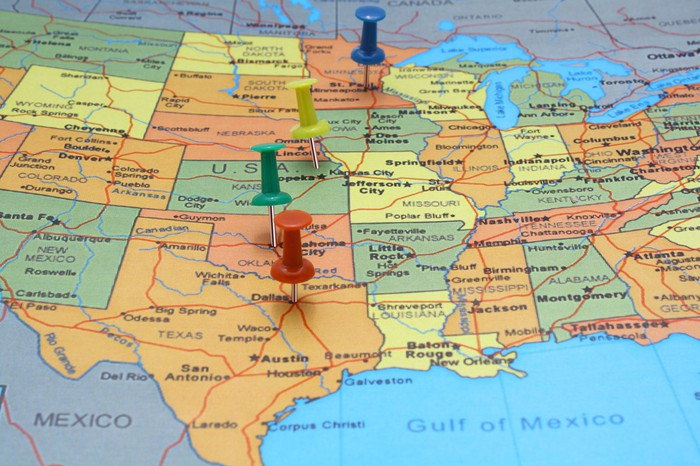 Map of much of the USA, with a few push pins stuck in it
