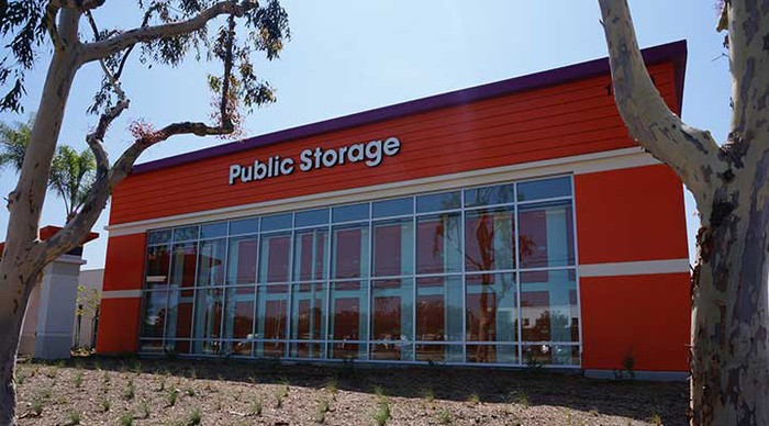 The front-door view of a newly built Public Storage facility, featuring the company's bright orange colors.