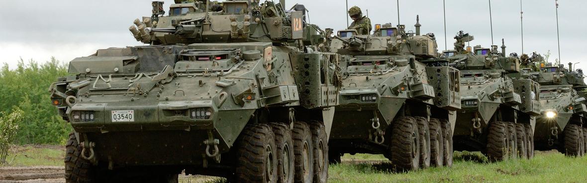 Column of LAV light armored vehicles.