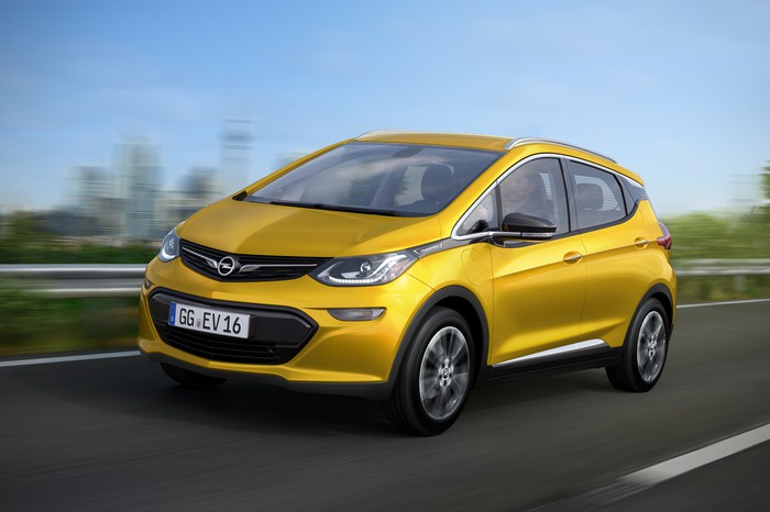 A yellow 2017 Opel Ampera-e on the road.