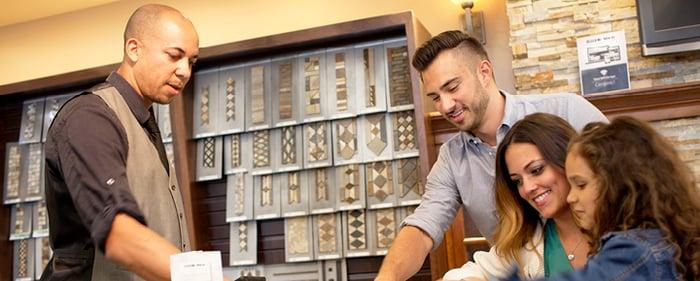 Tile Shop employee helping customers select tile.