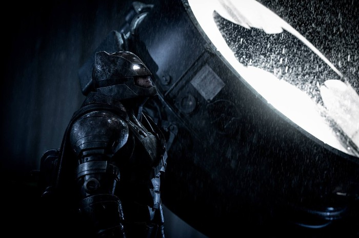 "Batman standing in front of a lit-up Bat Signal. Image from ""Batman v Superman."""