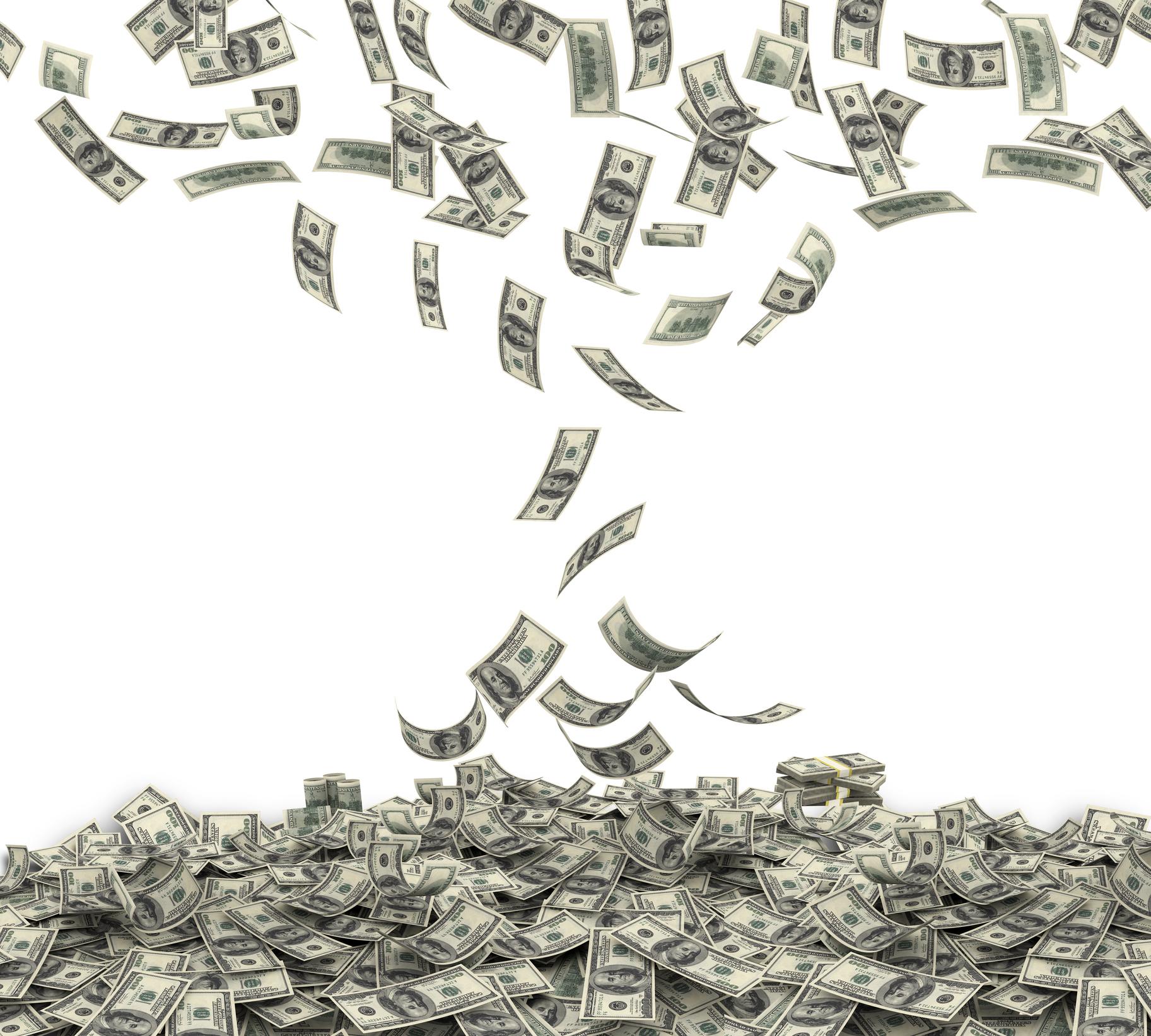 Money falling into large pile